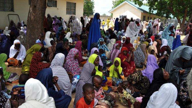 Civilians who fled their homes following an attacked by Islamist militants, in Bama, take refuge at a school in Maiduguri, Nigeria, Sept. 9, 2014. (Photo by Jossy Ola/AP)