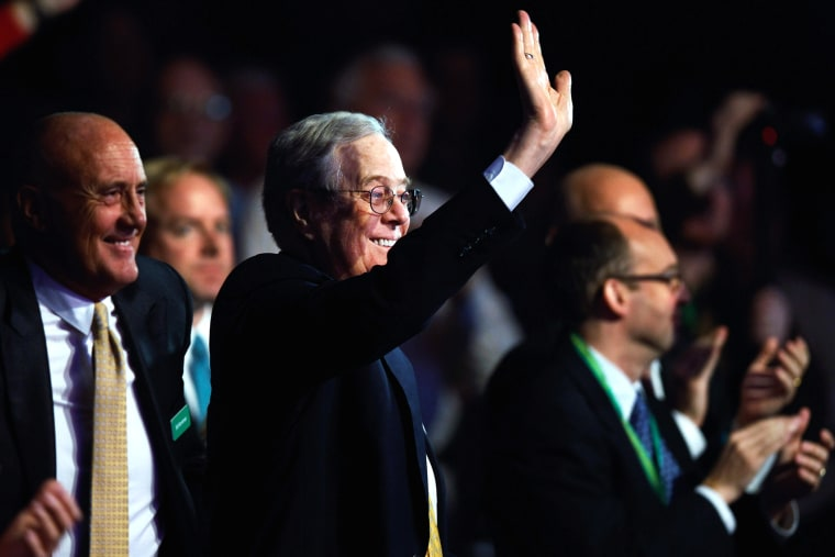 Americans for Prosperity Foundation chairman and Koch Industries Executive Vice President David H. Koch (C) waves during an event at the Washington Convention Center, Nov. 4, 2011 in Washington, DC. (Photo by Chip Somodevilla/Getty)