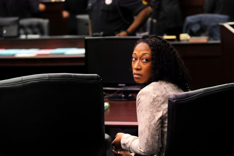 Marissa Alexander looks back to the gallery while the lawyers involved in the case have a sidebar discussion with Judge James Daniel Wednesday, April 2, 2014. (Photo by Bob Mack/The Florida Times-Union/AP)