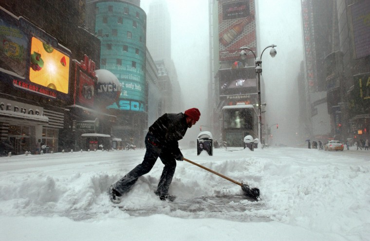 An identified man clears the snow in the center island in Times Square during a heavy blizzard, Feb. 12, 2006 in New York City. (Photo by Ramin Talaie/Bloomberg News)