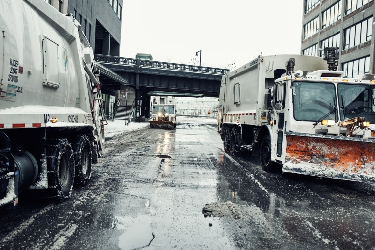 Snow plows clear the streets of the Meatpacking district of Manhattan on Jan. 27, 2015.