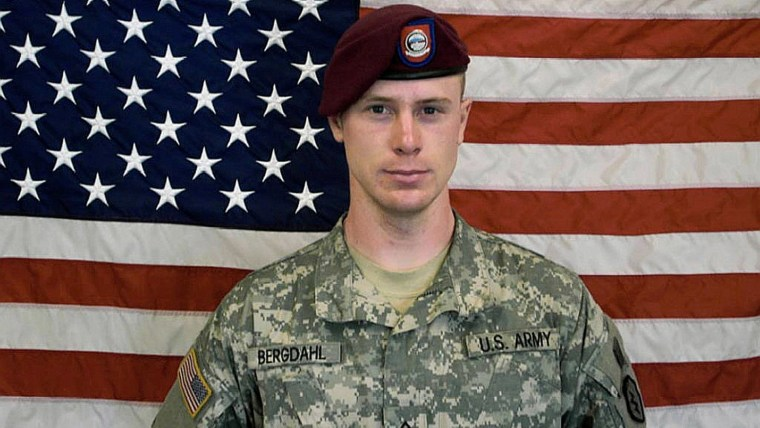 In this undated image provided by the U.S. Army, Sgt. Bowe Bergdahl poses in front of an American flag. (Photo by U.S. Army/Getty)