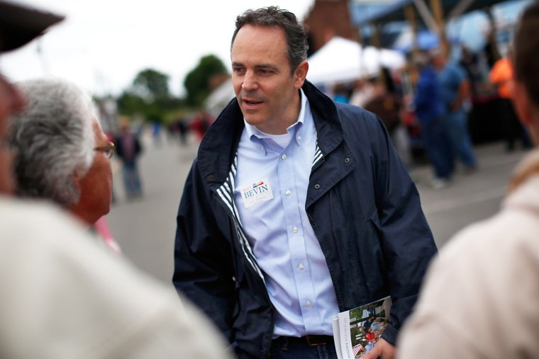 Then, Kentucky Republican senatorial candidate Matt Bevin talks with voters at the Fountain Run BBQ Festival while campaigning for the Republican primary May 17, 2014 in Fountain Run, Ky. (Photo by Win McNamee/Getty)