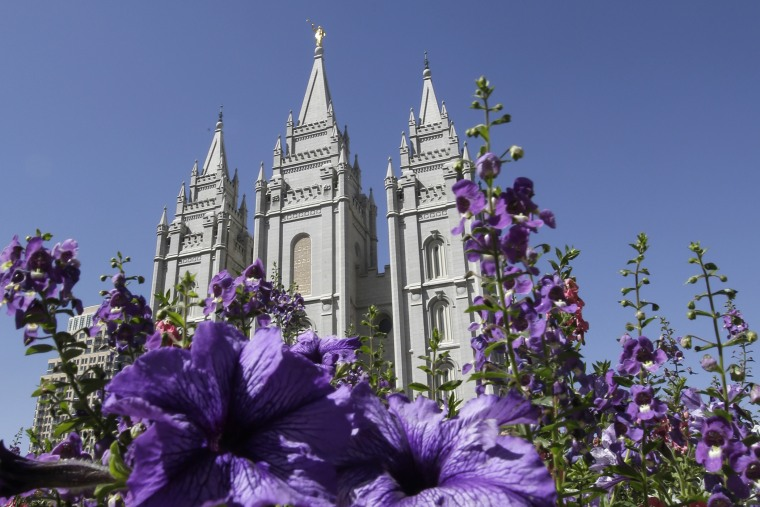 In this Sept. 3, 2014, file photo, shows flowers blooming in front of the Salt Lake Temple. in Temple Square, in Salt Lake City. (Photo by Rick Bowmer/AP)