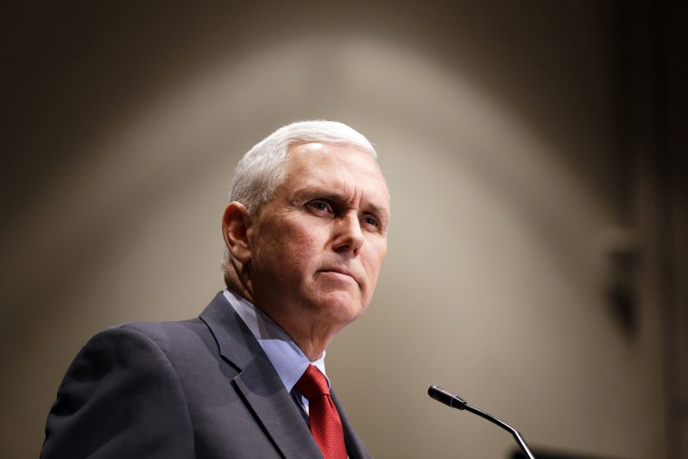 Indiana Gov. Mike Pence pauses during a speech in Indianapolis, on Jan. 27, 2015. (Photo by Michael Conroy/AP)
