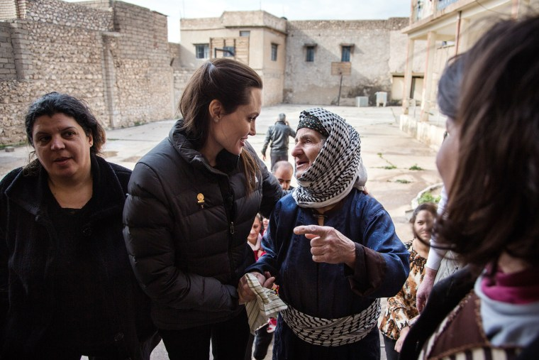 Angelina Jolie meets meets displaced Iraqis who are members of the minority Christian community, living in an abandoned school, on Jan. 26, 2015 in Al Qosh, Iraq. (Photo by Andrew McConnell/UNHCR/Getty)