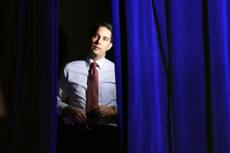 Wisconsin Gov. Scott Walker waits backstage before speaking at the Freedom Summit, Jan. 24, 2015, in Des Moines, Iowa. (Photo by Charlie Neibergall/AP