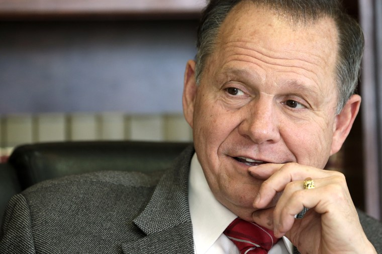 In this Oct. 24, 2012 file photo, former Chief Justice Roy Moore poses for a photo in his Montgomery, Ala., office. (Photo by Dave Martin/AP)