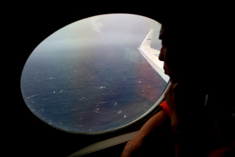 Koji Kubota of the Japan Coast Guard keeps watch for debris on board the Japan Coast Guard Gulfstream V aircraft whilst in the search zone for debris from Malaysia Airlines flight MH370 on April 1, 2014.