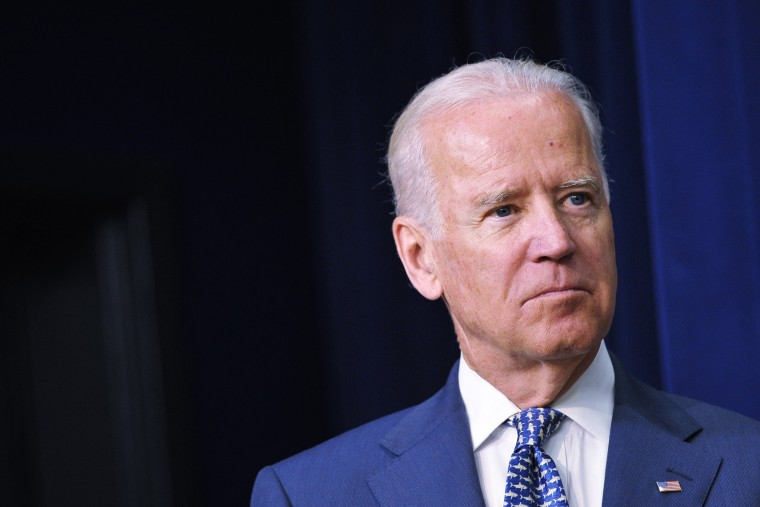 Vice President Joe Biden watches as President Barack Obama speaks during an event at the Eisenhower Executive Office Building on June 10, 2014 in Washington, D.C. (Photo by Mandel Ngan/AFP/Getty)