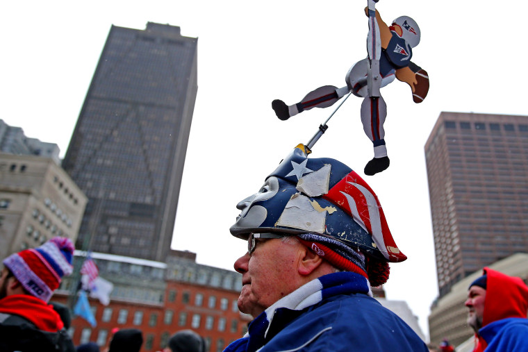Fans attend the New England Patriots Send-Off Rally at City Hall Plaza on Jan. 26, 2015 in Boston, Massachusetts. The Patriots will face the Seattle Seahawks in Superbowl XLIX on Sunday. (Photo by Maddie Meyer/Getty)