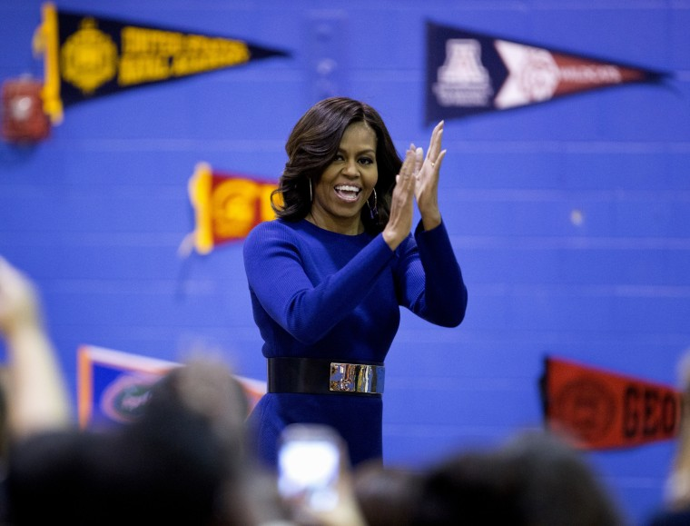 First lady Michelle Obama arrives to speak at Capital City Public Charter School in Washington, Dec. 5, 2014, during the second annual College Application March, part of her Reach Higher initiative. (Photo by Carolyn Kaster/AP)