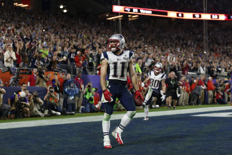 New England Patriots wide receiver Julian Edelman (11) celebrates after catching a touchdown pass against the Seattle Seahawks during Super Bowl XLIX at University of Phoenix Stadium on Feb. 1, 2015, in Glendale, Ariz.