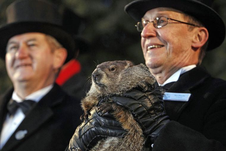 Groundhog Club handler Ron Ploucha (R) holds Punxsutawney Phil, the weather prognosticating groundhog, during the Groundhog Day celebration at Gobblers Knob in Punxsutawney, Pa., on Feb. 2, 2015. (Photo by David Maxwell/EPA)