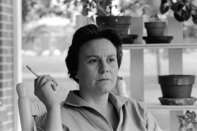 Portrait of American novelist Harper Lee smokes a cigarette as she sits on the porch of her parents home, Monroeville, Alabama, May 1961. (Photo by Donald Uhrbrock/The LIFE Images Collection/Getty)