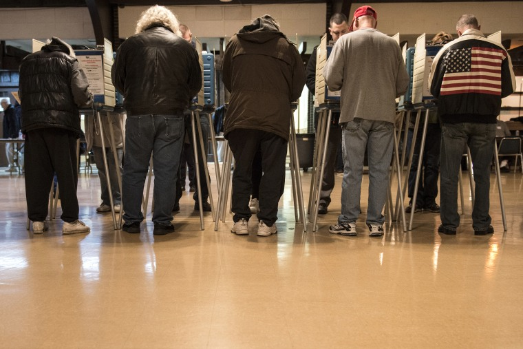 People vote at the United Auto Workers Local 1250 Hall during election day Nov. 6, 2012 in Cleveland, Ohio. (Photo by Brendan Smialowski/AFP/Getty)
