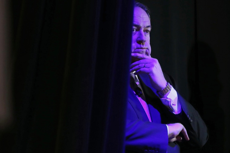 Former Governor of Arkansas Mike Huckabee listens to his introduction from the side of the stage at the Freedom Summit in Des Moines, Iowa, Jan. 24, 2015 (Photo by jim Young/Reuters)