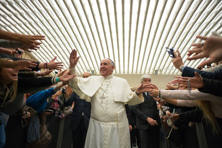 Pope Francis is cheered by faithful upon his arrival for the weekly general audience in the Pope Paul VI hall, at the Vatican, Feb. 4, 2015. (Photo by L'Osservatore Romano/Pool/AP)