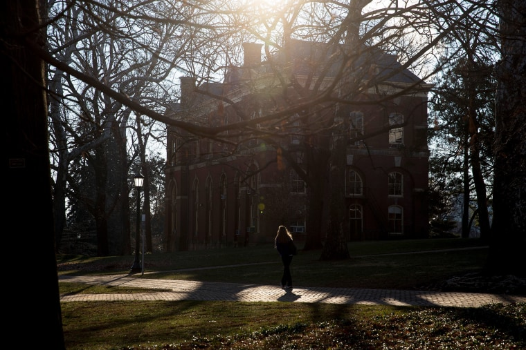 A student walks near Brooks Hall on the University of Virginia campus in Charlottesville, Va., on Jan. 17, 2015. (Photo by Andrew Harrer/Bloomberg/Getty)