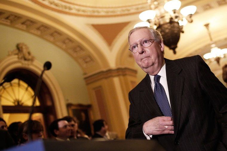 Senate Majority Leader Mitch McConnell (R-KY) arrives to take questions from members of the press following a weekly policy luncheon with Senate Republicans at the U.S. Capitol on Jan. 13, 2015 in Washington, D.C. (Photo by Win McNamee/Getty)