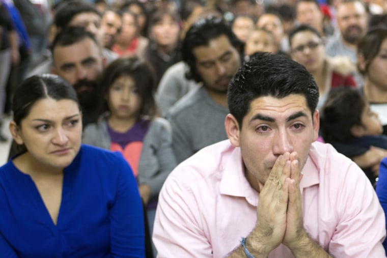 Viridiana Carrizales of San Antonio and Jose Patino, of Phoenix react during a watch party for President Obama's speech on immigration at the Puente offices in Phoenix on Nov. 20, 2014. (Photo: David Wallace/The Republic/AP)