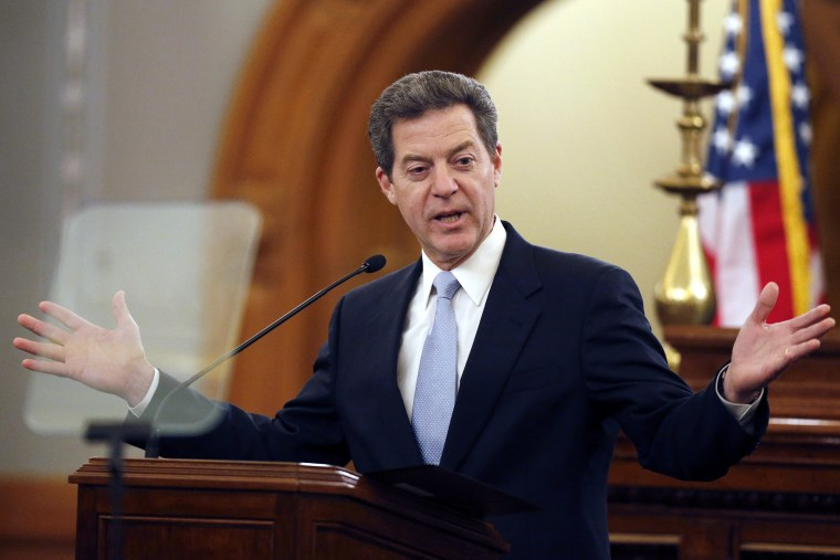 Kansas Gov. Sam Brownback delivers his State of the State speech to an annual joint session of the House and Senate at the Statehouse in Topeka, Kan., Jan. 15, 2014. (Photo by Orlin Wagner/AP)