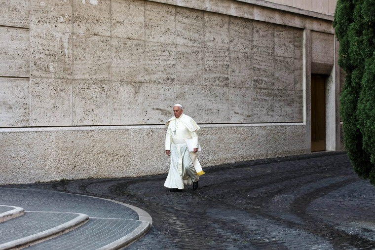 Pope Francis arrives at the morning session of a two-week synod at the Vatican, Oct. 6, 2014. (Photo by Alessandra Tarantino/AP)