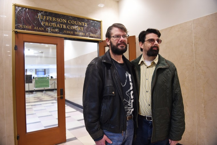 Couple Greg Mullins, left, and Josh Laning, right, both of Birmingham, stand outside the Jefferson County Courthouse Probate office in Birmingham, Ala., on Jan. 26, 2015, after going trying to get a marriage license. (Photo by Tamika Moore/AL.com/Landov)