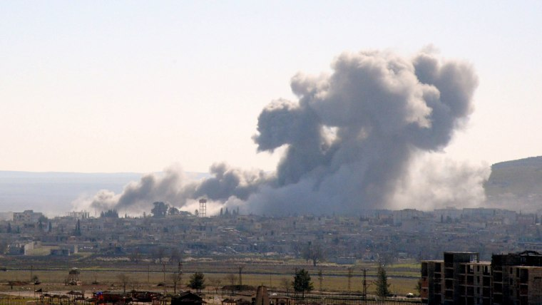 Smoke rising from the Syrian border town of Kobani (Ayn al-Arab) following the US-led coalition airstrikes against the Islamic State targets near Mursitpinar border crossing on Jan. 23, 2015 in Suruc, Turkey. (Photo by The Asahi Shimbun/Getty)