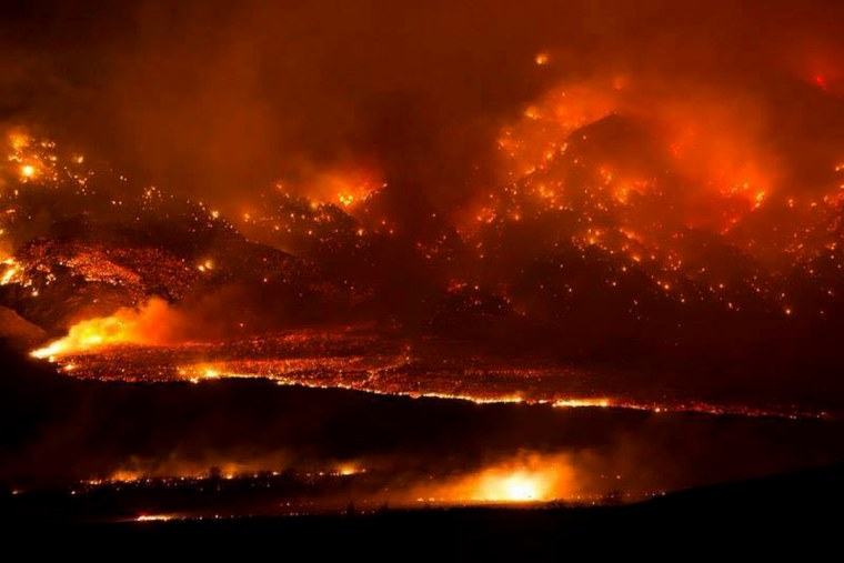 The Round fire burning at Wheeler Crest near Bishop Calif. Friday Feb. 6, 2015. The wildfire has destroyed 40 homes and forced about 150 people to leave two small California towns at the eastern base of the Sierra Nevada. (Photo by Jim Stimson/CalFire/AP)