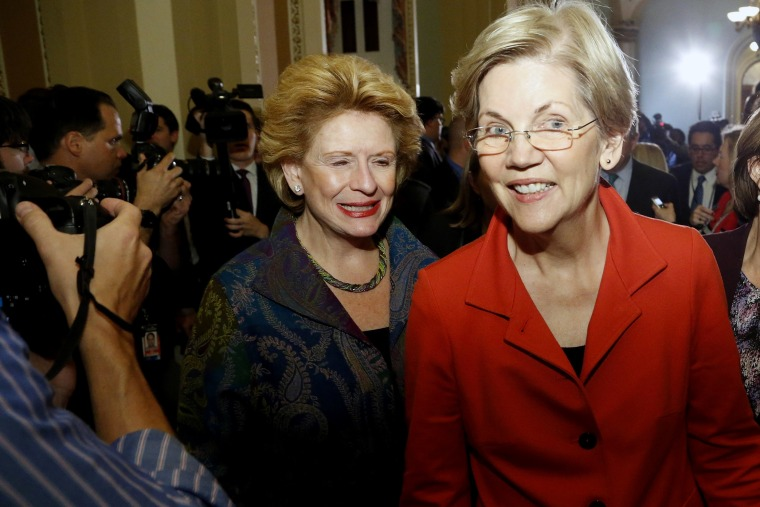 US Senator Elizabeth Warren, flanked by Senator Debbie Stabenow and Senator Amy Klobuchar leaves after speaking to reporters following a leadership election for the 114th Congress in Washington, Nov. 13, 2014. (Photo by Jonathan Ernst/Reuters)