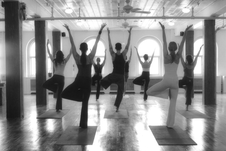 A yoga class. (Photo by Sally Gall/Gallery Stock)