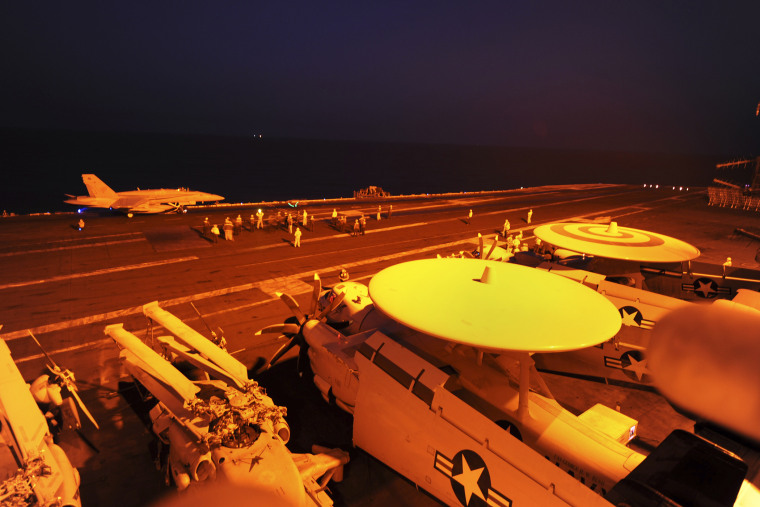 In this file photo released by the U.S. Navy on Tuesday, Sept. 23, 2014, A-18C Hornet prepares to launch from the flight deck to conduct strike missions against Islamic State group targets, in the Arabian Gulf. (Robert Burck/U.S. Navy-File/AP)