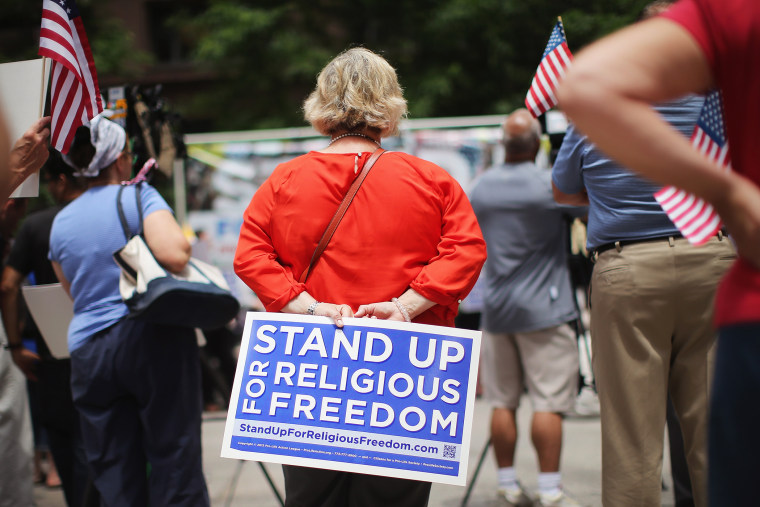 Religious freedom supporters hold a rally on June 30, 2014 in Chicago, Ill. (Photo by Scott Olson/Getty)