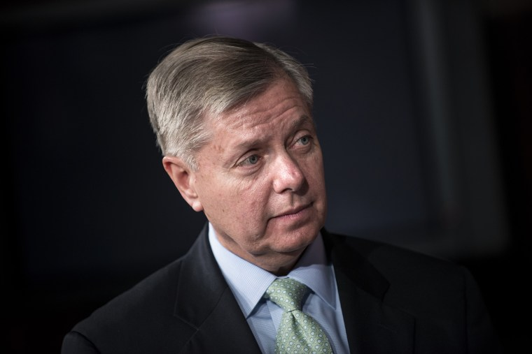 Senator Lindsey Graham (R-SC) listens during a press conference on Capitol Hill March 7, 2013 in Washington, D.C.