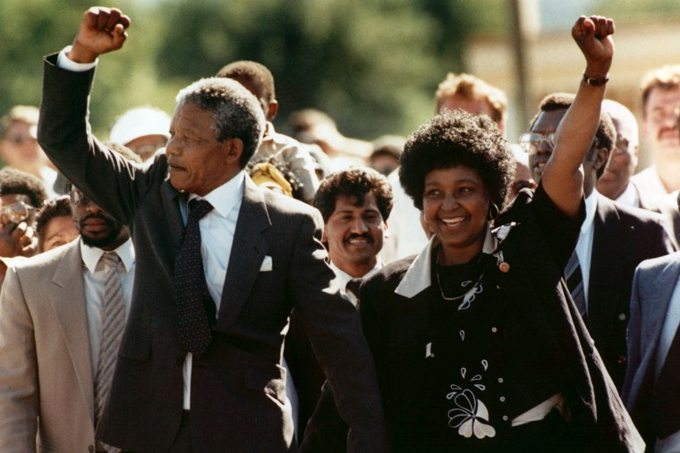 Nelson Mandela and wife Winnie, raise clenched fists upon his release from prison in Cape Town on Feb. 11, 1990. (Photo by Greg English/AP)