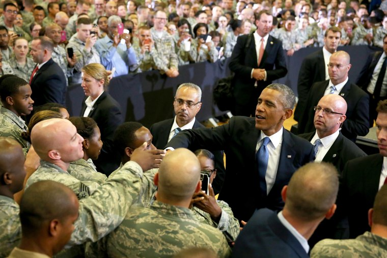 U.S. President Barack Obama greets soldiers during a visit to the U.S. Central Command at the MacDill Air Force Base on Sept. 17, 2014 in Tampa, Fla. (Photo by Joe Raedle/Getty)