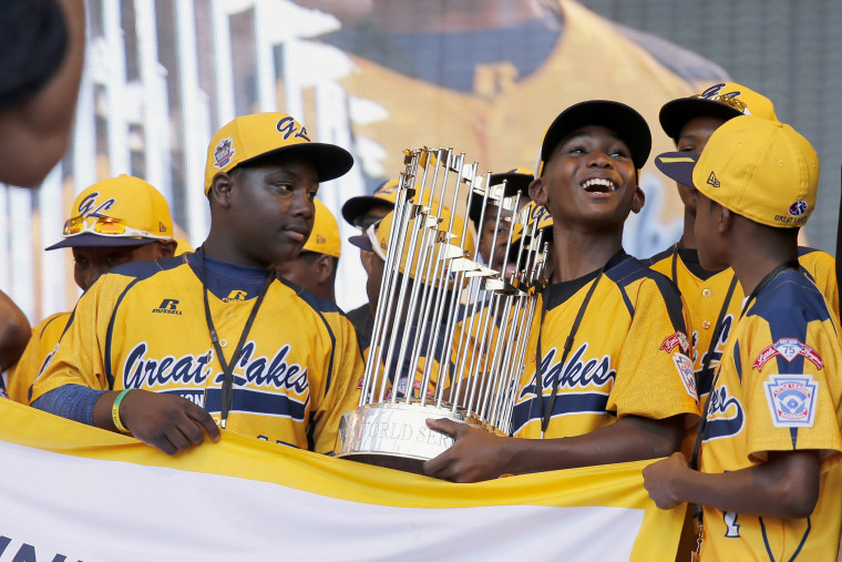 In this Aug. 27, 2014, file photo, members of the Jackie Robinson West Little League baseball team participate in a rally in Chicago celebrating the team's U.S. Little League Championship. (Photo by Charles Rex Arbogast/AP)