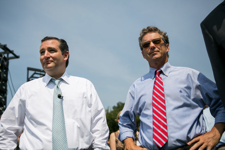 U.S. Sen. Ted Cruz (R-TX) (L) and Sen. Rand Paul (R-KY) wait to speak at an event on Sept. 10, 2013 in Washington, DC.