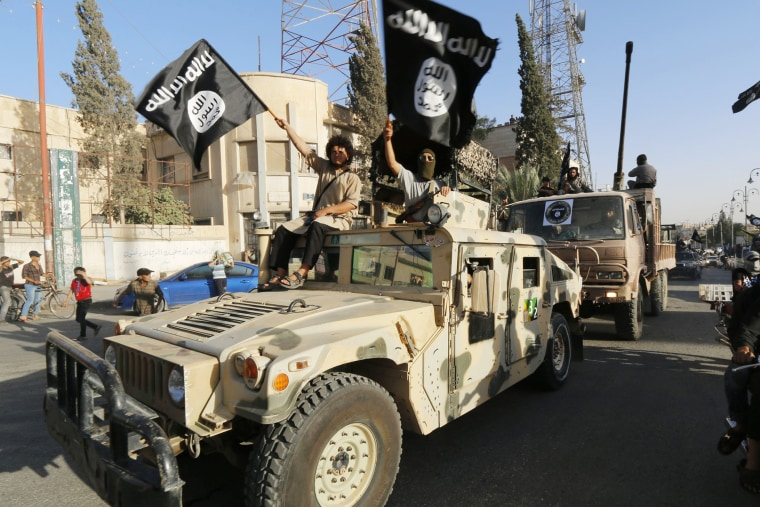 Militant Islamist fighters take part in a military parade along the streets of Syria's northern Raqqa province June 30, 2014. (Photo by Reuters)