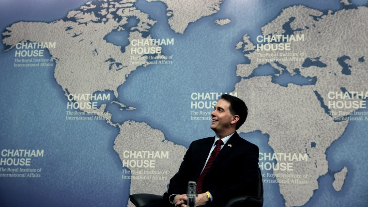 Wisconsin Gov. Scott Walker laughs as he is introduced prior to his speech at Chatham House in central London, Feb. 11, 2015. (Photo by Lefteris Pitarakis/AP)