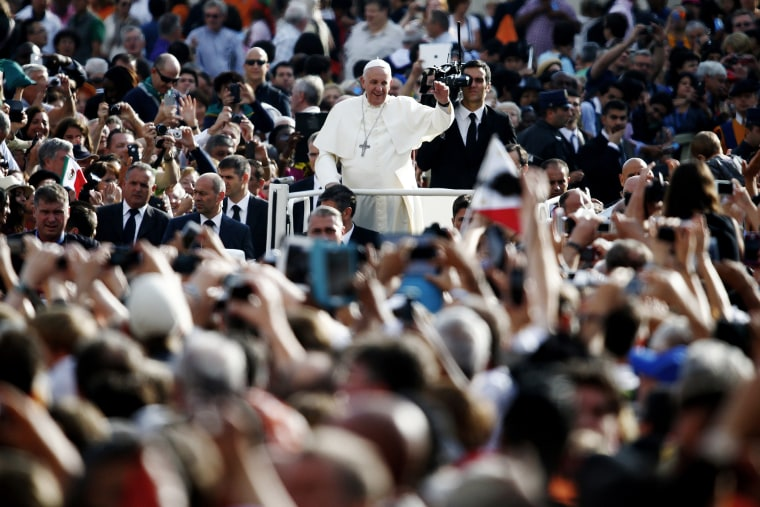 Pope Francis waves as he leads his weekly audience in Saint Peter's Square at the Vatican on Oct. 1, 2014. (Photo by Tony Gentile/Reuters)
