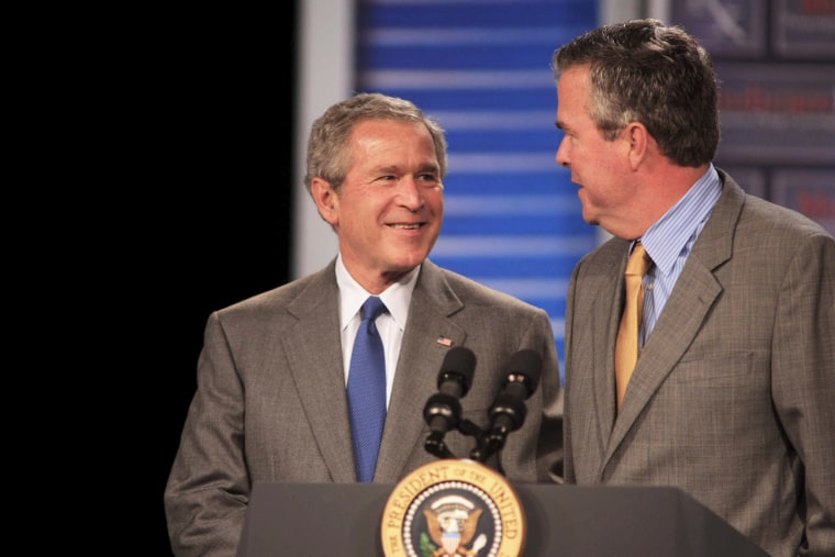 President George W. Bush (L) smiles at his brother Florida Governor Jeb Bush before making remarks at an event in Sun City Center, Fla., on March 8, 2006. (Photo by Chris Livingston/EPA)