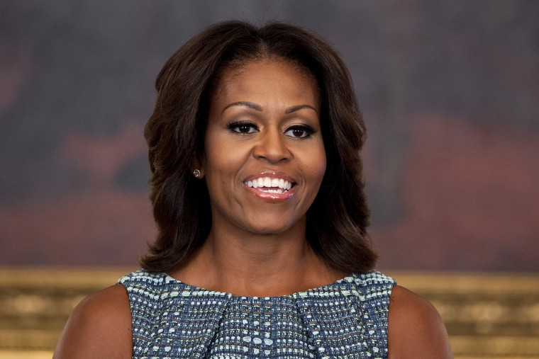 First lady Michelle Obama pauses during an event in the State Dining Room of the White House on Sept. 18, 2013, in Washington, D.C. (Photo by Evan Vucci/AP)
