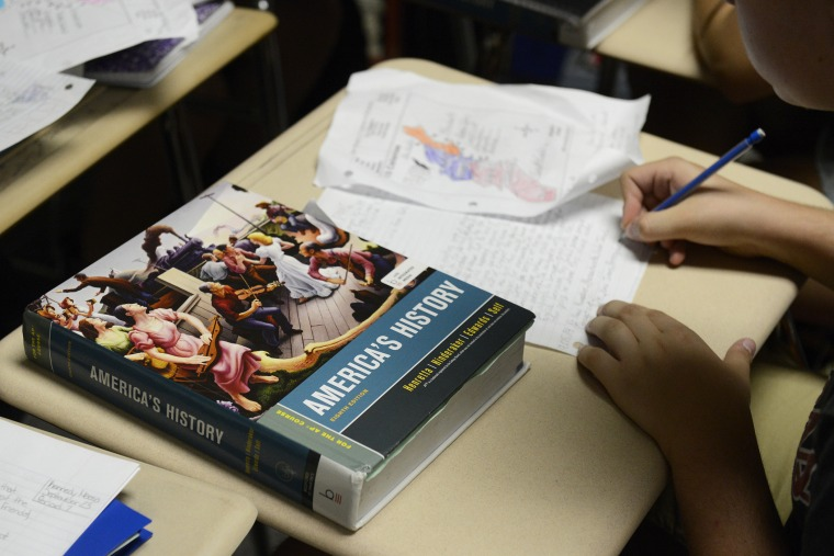 An America's History text book sits on a student's desk in an AP U.S. History class in Colorado. (Photo by Andy Cross/The Denver Post/Getty)
