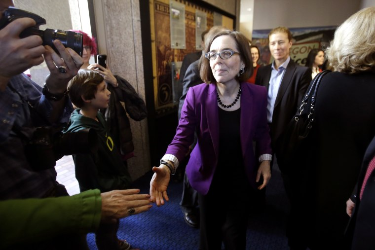 Oregon Secretary of State Kate Brown greets people during a celebration at the Oregon Historical Society to mark the 156th anniversary of Oregon's admission to the union as the 33rd state in Portland, Ore., Feb. 14, 2015. (Photo by Don Ryan/AP)