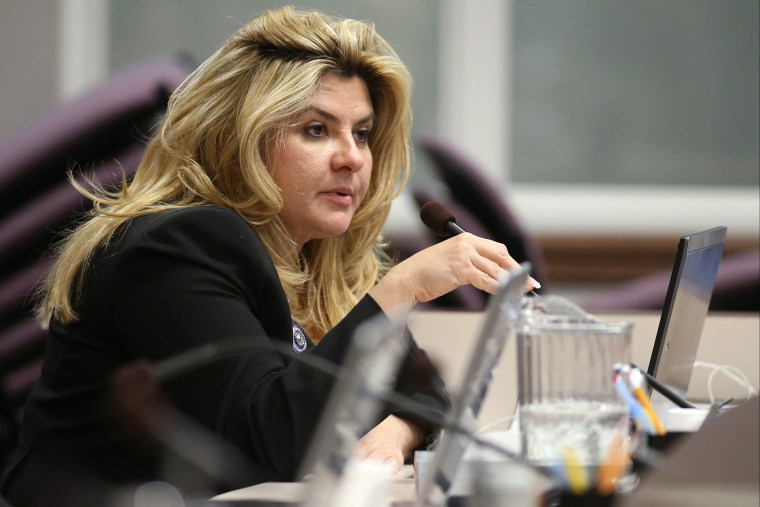 In this June 3, 2013, file photo, Nevada Assemblywoman Michele Fiore, R-Las Vegas, works in committee during the final day of the 77th Legislative session at the Legislative Building in Carson City, Nev. (Photo by Cathleen Allison/AP)