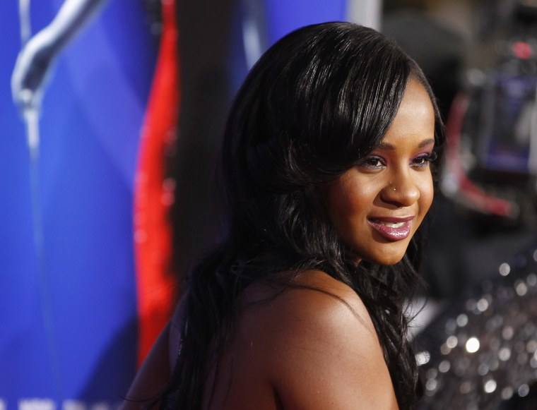 """Bobbi Kristina Brown, daughter of the late singer Whitney Houston, poses at the premiere of """"Sparkle"""" in Hollywood, Calif., Aug. 16, 2012. (Photo by Fred Prouser/Reuters)"""