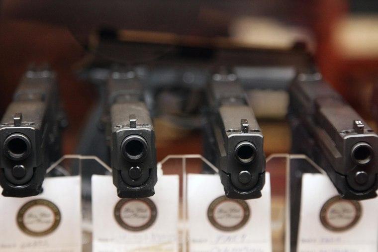 Handguns are displayed in the sales area of Sandy Springs Gun Club and Range, in Sandy Springs, Ga.