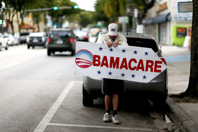 Pedro Rojas holds a sign directing people to an insurance company where they can sign up for the Affordable Care Act, also known as Obamacare, before the February 15th deadline on Feb. 5, 2015 in Miami, Fla. (Photo by Joe Raedle/Getty)